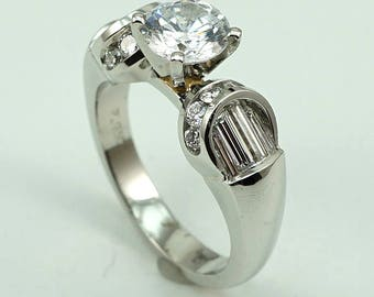 Platinum Engagement Ring CZ Center Stone with 18-Diam Side Stones at 0.64 Cts.