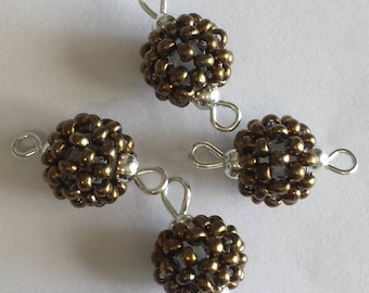 bronze 4 seed connectors (2mm) beads