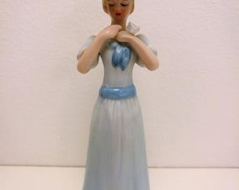 Woman porcelain figurine