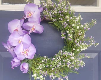 Designer spring and summer orchid floral wreath. Purple moth orchid and white flowers with faux greenery. Nice rustic farmhouse decor.