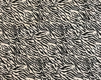 Black and white tiger print on a light weight cotton pinwale corduroy