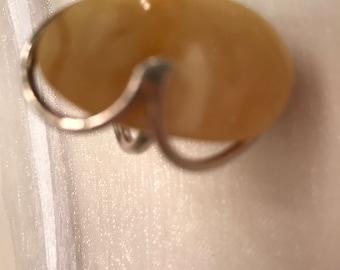 Large elegant amber statement ring set in sterling silver.
