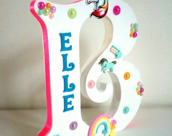 Freestanding solid wooden embellished personalised letters or numbers in any theme. Photo is Unicorn theme.