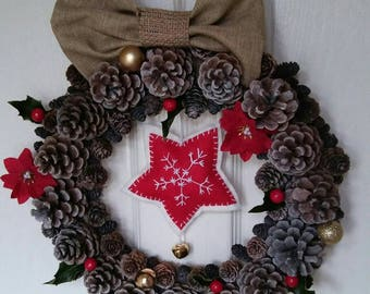 Christmas wreath, pine cones decoration to hang on the door or a wall
