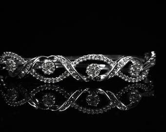 14kt White Gold bangle with Diamonds