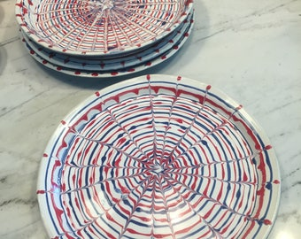 Red White and Blue dinner plates. Also 4 dessert plates.