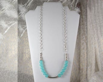"""Simplicity. Two Rows of Aqua Semi-transparent Balls separated by Silver Finish Accents. 28"""" Long.  Silver Finish Chain. Lobster Claw Clasp"""
