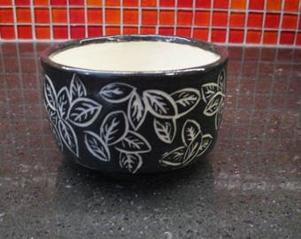 ceramic bowl with leaf sgraffito design