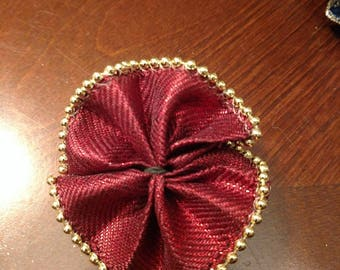 Festive red and gold collar bow