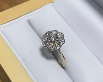 A Diamond Daisy Head Cluster Ring In 18 Carat Gold