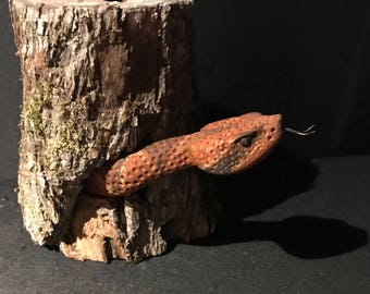 Carved Snake in a log