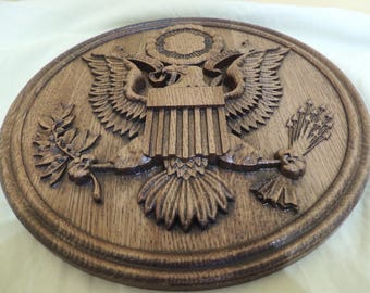 Blazonry. Carved wooden emblem of USA.American eagle eagle wood carving
