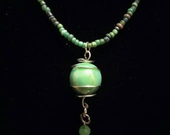 Green marble wire wrapped with a light green charm