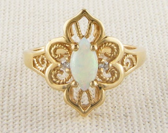 Classic Opal and Diamond ring in 14K Yellow Gold