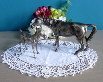 Vintage; Couple of horses Tin; a Mare and foal
