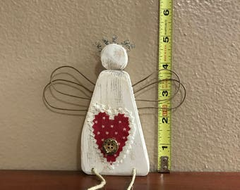 Primitive wood and wire angel