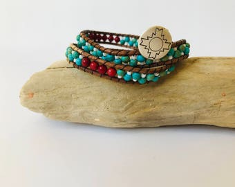 Beautiful handmade Native American inspired Turquoise and Red Coral wrap bracelet.