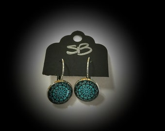 Drop earrings with mandala design