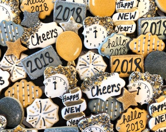 Decorated NEW YEARS EVE 2018 themed cookies in black, gold, silver and white
