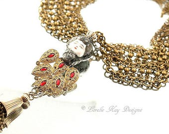 The Queen Statement Necklace Sculpted China Doll Head Red & Gold Frozen Charlotte Doll Head with Crown Pendant