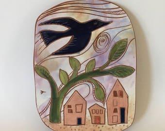 bird flying over houses hand carved ceramic art tile