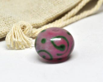 Pink and green lampwork bead