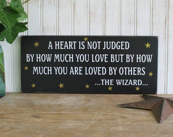 A Heart is not Judged Wizard Of Oz Wood Sign  Wall Decor Inspirational Wall Art Plaque Tin Man
