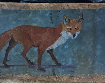 Red Fox on metal and wood
