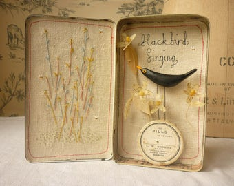 Original artwork - mixed media - sculpted bird and flowers in vintage tin