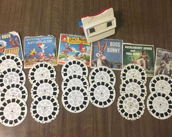 Vintage Viewmaster with 17 Reels Walt Disney Donald Duck Quick Draw McGraw Woody Woodpecker Bugs Bunny Yogi Bear Birth of Jesus