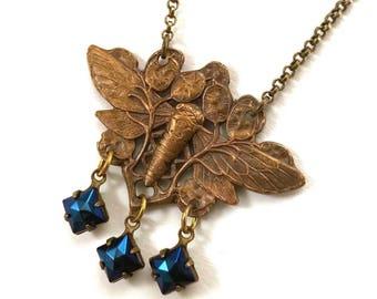 Antique bronze Art Nouveau Moth necklace with vintage iridescent blue glass drops