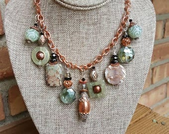 Mixed metal handmade charm necklace. Copper, Silver, Agate,Jasper, Pearl.Funky and modern.Soft greens and earthtones on a rosy copper chain.