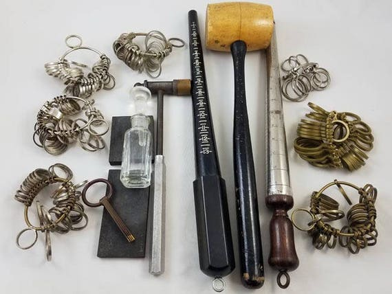 Lot grouping of vintage jewelers tools / ring sizers / hammer / mallet / gold testing stone / gold tester / jewelry supply / ring mandrel