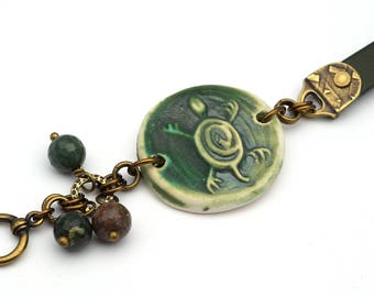 Green turtle bracelet, ceramic leather brass, bloodstone beads, 7 1/2 inches long