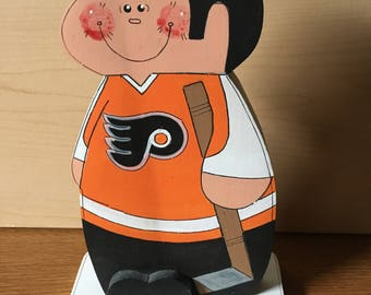 Philadelphia Flyers hockey player,wood, hand painted , handmade, 3/4 inch wood, 8 inches tall, weighs 6 oz.
