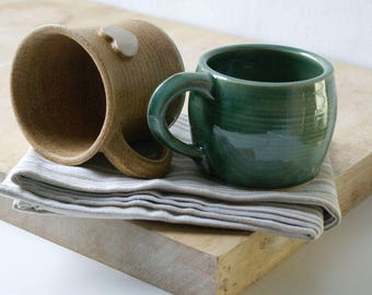 Two mismatched mugs - glazed in forest green and natural brown
