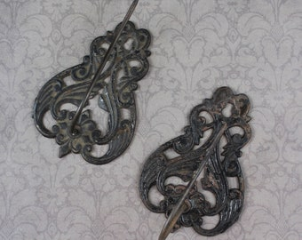 Pair of Vintage Cast Iron Receipt Hooks