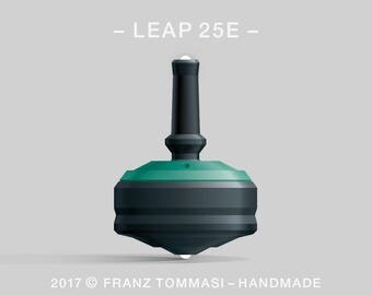 LEAP 25E Green-on-Black Spin Top with rubber grip, dual ceramic tip, two-part body, and accent holes (3)