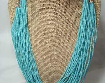 Vintage Multi Strand Turquoise Colored Seed Beads Necklace.