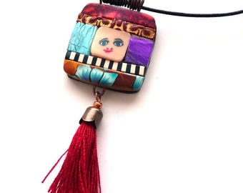 The small face in polymer clay Medallion necklace