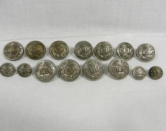 15 Silver Tone Metal FD Buttons, 11 Approx 7/8 of an inch, 4 Approx 1/2 Inch, Marked