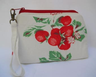 Strawberries everywhere on this little bag.  Perfect size for using as a wristlet or remove the strap to use as a carryall