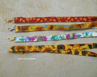Sunflower Fabric lanyards plus charms. Five  styles to choose from. Gift idea, key holder, new driver, teachers and aides.