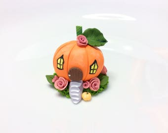 Miniature pumpkin fairy house cake topper made from polymer clay