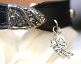 Leather cuff with silver rivets and  Michael the Arch dangle