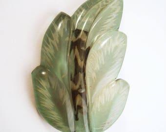 Reverse carved lucite leaf brooch