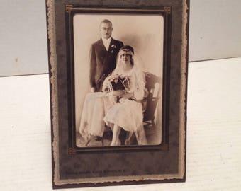 Vintage Photo of Wedding Couple Sitting at Tabel