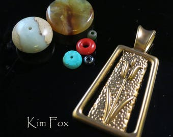 Tulip Pendant with large bail in Golden Bronze designed by Kim Fox 1 3/4 by one inch in size