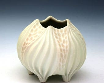 Carved porcelain pale yellow and pink squat vase, urchin vessel