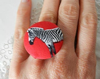 Adjustable ring in red fabric, zebra
